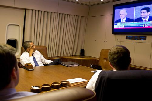 Obama watches VP debate on CNN from Air Force 1